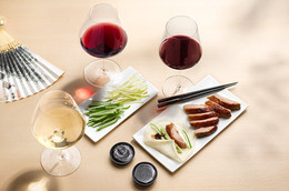 Why do Austrian wines pair well with Asian cuisine?