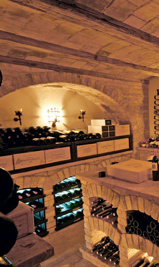 Above from left: Italian wine cabinet from La Cantina di Paul; a vaulted stone cellar by Friedrich Gruber
