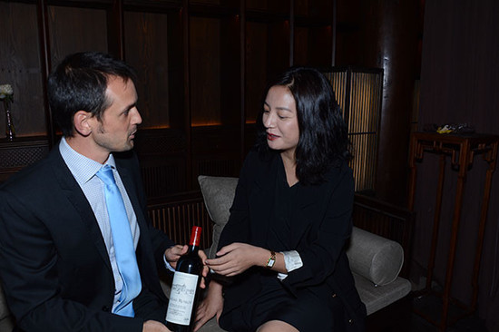 Zhao Wei and Chateau Monlot winemaker Jean de Cournuaud at private wine tasting in Beijing