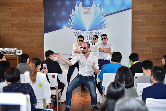 Image: Julien Boulard performing with Chinese wine educators at Wine Stars of China, credit Aroma Republic