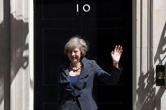 Housewarming: Theresa May outside number 10 Downing Street. Credit: Carl Court / Getty Images