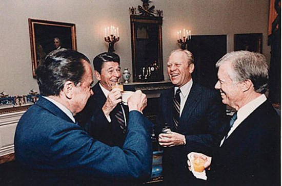 Image: (Left to right) Nixon, Reagan, Ford and Carter raise a glass in the Blue Room, 1992. Credit: Getty