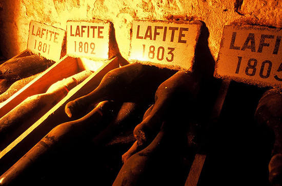 Bottles of Lafite from the early 19th Century in the château cellars in Bordeaux.