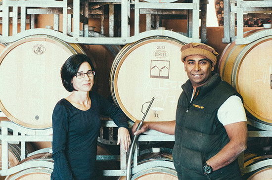 Former scientists Maree Collis and Ray Nadeson in the barrel room at Lethbridge Wines.
