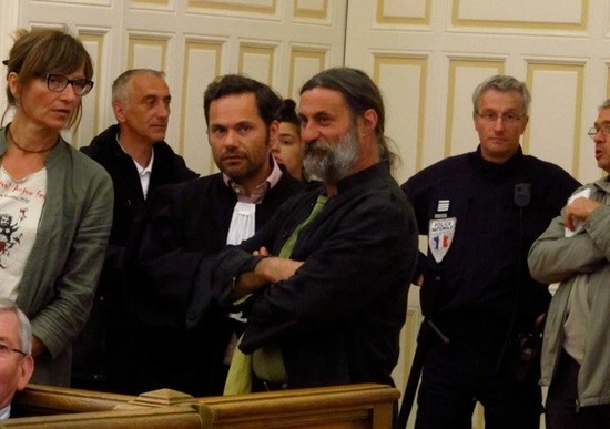 Olivier Cousin (centre) in court in Angers