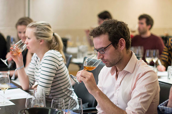 Tasting wine at a Decanter 'discovery theatre' class on Muscat de Rivesaltes. Credit: Decanter / Soora.co.uk